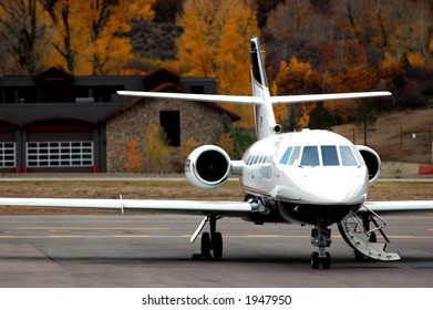 close up of private jet on tarmac ready for passenger boarding