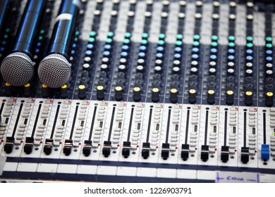 close up of professional console in recording mixer studio