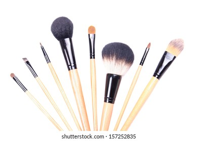 close up of professional make-up brushes isolated on white background