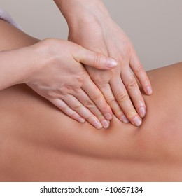 Close up of professional massage  on the lower back muscle