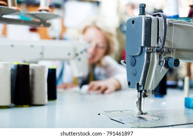 close up of professional sewing machine with needle and thread passed through it