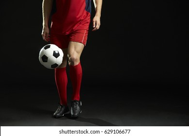 Close Up Of Professional Soccer Player With Ball In Studio