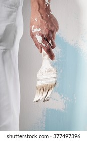 Close up Of Professional Workman Hand holding Dirty Paintbrush