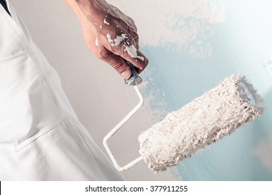 Close up Of Professional Workman Hand holding Dirty Paint roller
