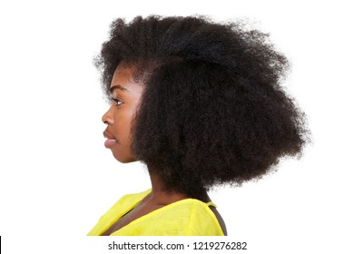 Close up profile portrait of attractive young black woman with afro hair against isolated white background