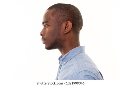 Close up profile portrait of handsome young black man against isolated white background