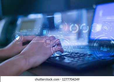 close up programmer man hand typing keyboard input code for register and unlock system password on laptop in darkness operation room with virtual reality interface, cyber security and gdpr concept