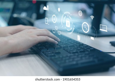 close up programmer man hand typing keyboard input code for register and unlock system password on laptop in darkness operation room with virtual reality interface, cyber security concept