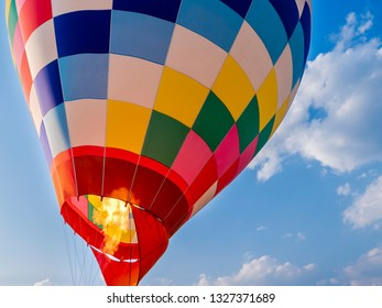 Close up of propane gas fire burner in hot air balloon for take off under blue sky and white cloud at Chiangrai, Thailand