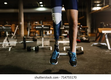 Close up of prosthesis leg of young man training in the gym. Disabled Sportsman Concept.