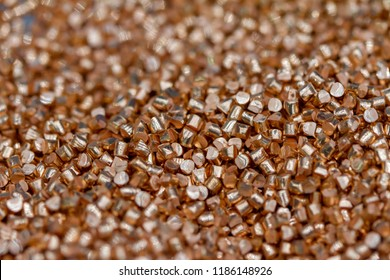 Close up of pure copper cylindrical granulate