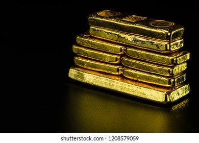 close up pure gold bar ingot put on the black color surface background represent the business and finance concept idea, Real gold bars background