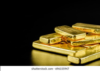 close up pure gold bar ingot put on the black color leather surface background represent the business and finance concept idea