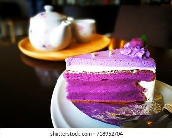 Close up of purple sweet potato cake on a white plate.