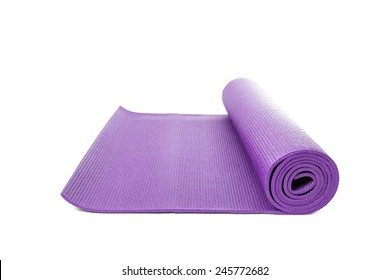 Close up purple yoga mat for exercise isolated on over white background