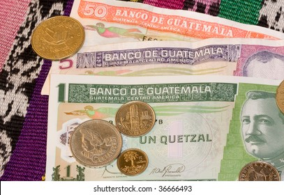 Close up of Quetzales, the currency of the country of Guatemala. Coins on notes.