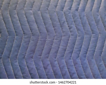 close up of quilted fabric with zigzag pattern