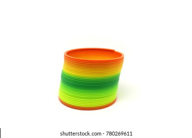 close up rainbow spring toy on white background
