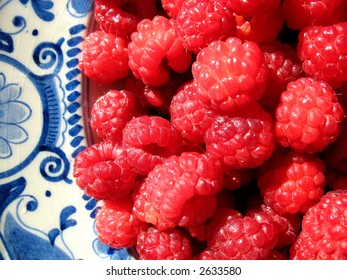 Close up of raspberries on antique plate