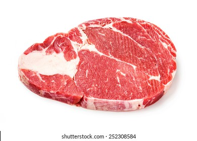 Close up raw beef rib eye steak isolated on white - deep focus image