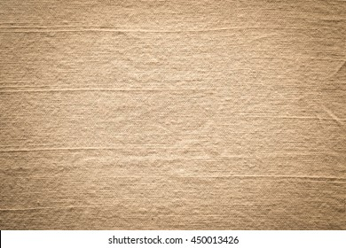 Close up raw brown burlap texture wall background.
