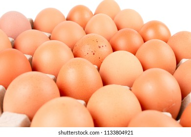 Close up Raw brown Chicken Eggs In paper container tray box isolated on white background. The egg in the middle there is the flaw is spot.
