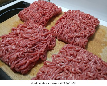 Close up of raw low fat beef mince preparing on a wooden board