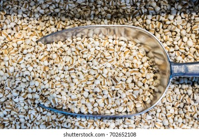 Close up Raw Millet on a scoop in millet pile. wholegrain  for clean food and lean food. healthy vegetable food. iamge for object and copy space.