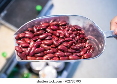Close up Raw red beans on a scoop in the market. wholegrain  for clean food and lean food. healthy vegetable food. iamge for object and copy space.