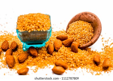 Close up of raw uncooked dalia or Bulgur or mixed cereals or oats with dry fruits ingredients for dalia kheer. A Asian sweet dish or dessert served in summer after the meal or lunch.