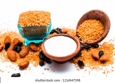 Close up of raw uncooked dalia or Bulgur or mixed cereals or oats with dry fruits and milk ingredients for dalia kheer. An Asian sweet dish or dessert served in summer after the meal or lunch.