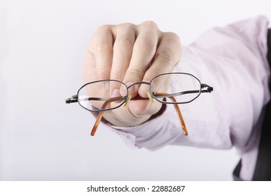 close up of reading glasses presented to costumer