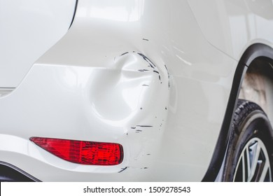 Close up  rear bumper of the car is dented from a car accident.