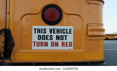 Close up of the rear end of a school bus that does not turn on red.
