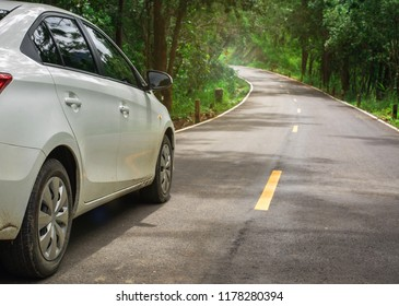Close up rear of old white car rent broken on the asphalt road in country sidt in forest ,copy space.