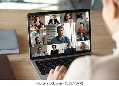 Close up rear view businesswoman holding briefing with diverse colleagues, engaged in conference, sitting at desk in office, business people on laptop screen, internet negotiations, online meeting - Shutterstock ID 1835770792