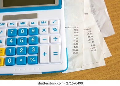Close up of receipt paper and caculator, payment