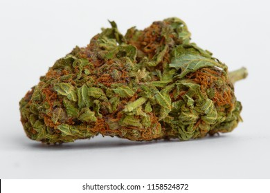 Close up of recreational and prescription medical marijuana indica flower bud isolated on a white background