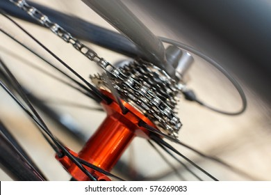 close up of red anodized rear hub and nine speed cassette for aluminum sport bicycle