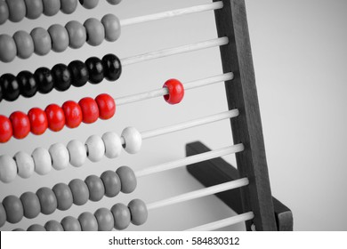 Close up of Red and black abacus art concept, traditional abacus in front of black and white tone background, vignette effect design. Selective focus and copy space.