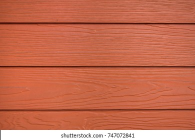 Close up red or brown wood substitute board and high quality of fiber board  texture and background for design and architect ,Beautiful wooden plank patterns from cement striped wood wall