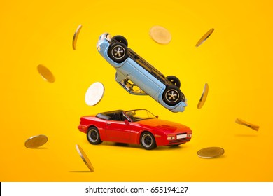 Close up red car and blue car accident with golden coin splash scene, Car crash insurance and lose money. Saving, Financial, Installment payment , Travel, Transport and Accident concept.