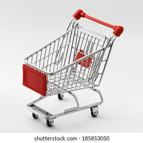 close up of red chrome shopping cart on white background
