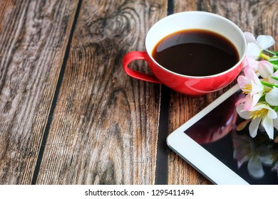 Close up of red coffee cup on wooden table.