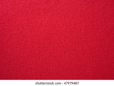 Close up of red colored wool textile  in Hi-Res
