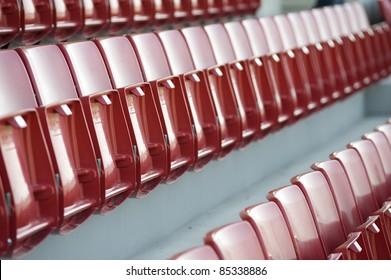 Close up Red Empty stadium chairs,