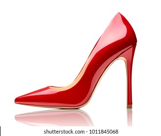 close up of red high heels on white background