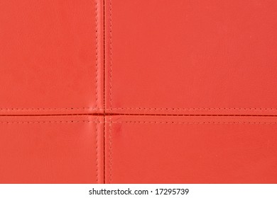 Close up of red leather stitching