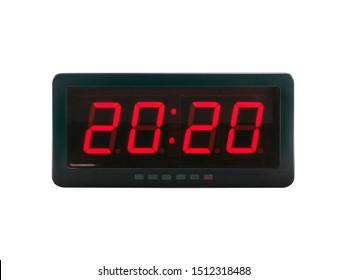 close up red led light illumination numbers 2020 on black digital electric alarm clock face isolated on white background, time symbol concept for celebrating the New Year