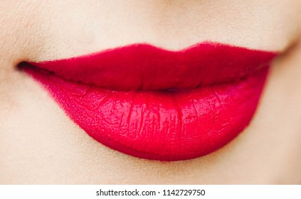 Close up Red lipstick on woman's lip ,Selective focus